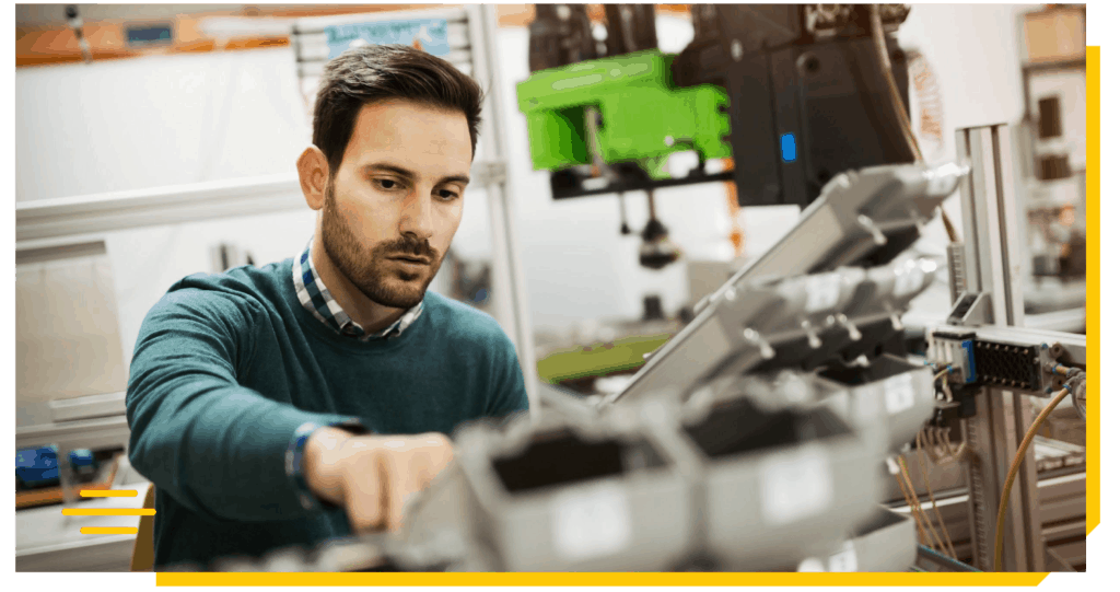 male engineer operating a manufacturing process