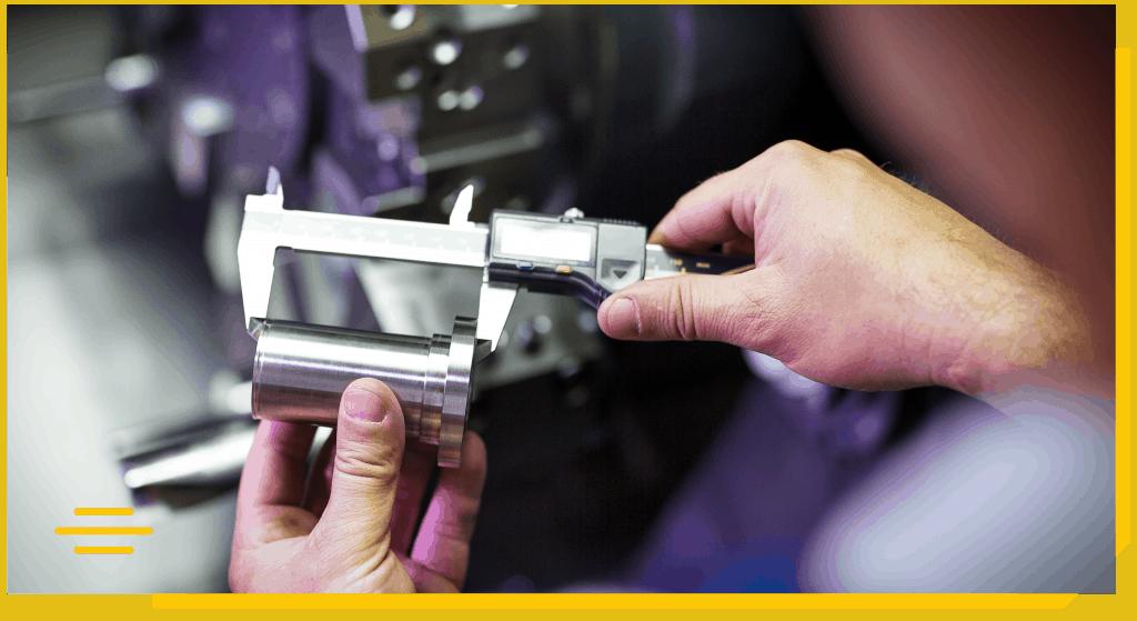 Technician inspects a mechanical part by vernier caliper
