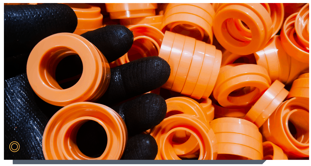 Operator holding a bunch of injection moulded parts