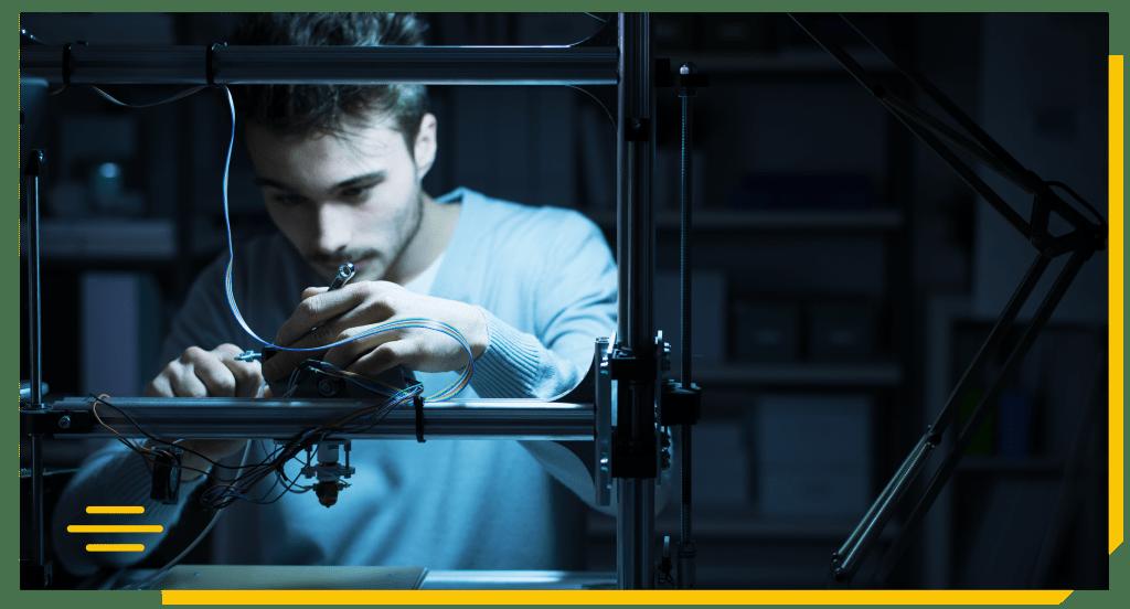 Engineer adjusting a 3D printer's components