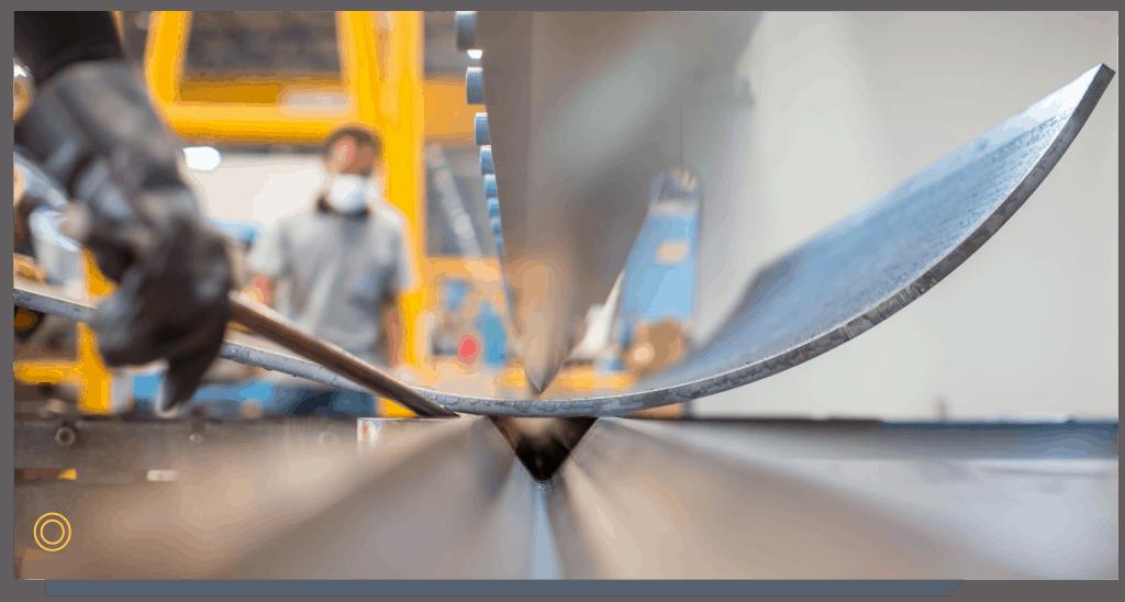Operator bending a sheet metal part