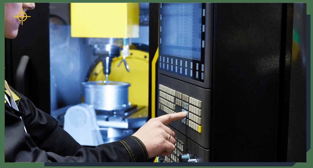 Technician checking a cnc machine