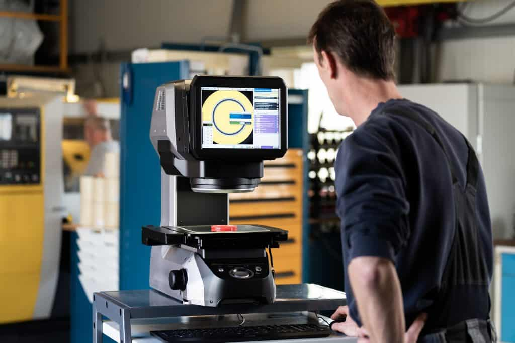 Technician checking the digital profile projector for visual inspection